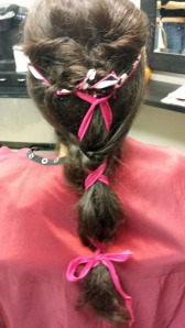 Above are two of our silk ribbons, Zebra/Pink Edges Item #AP103 and Mixed Pink Item #219 tied together and intertwined in a funky spin on a ponytail.