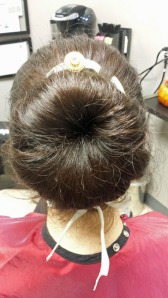 Attention Brides-to-Be! This is a fun spin on a classic, hairstyle on your special day. Our Off White/Gold silk ribbon, Item #309, was woven into Agnieszka's hair with a simple gold pendant to create a beautiful touch to her elegant bun.