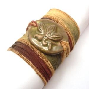 Silk ribbon wrist wrap with ceramic pendant